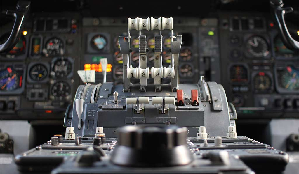 Close-up photograph of a Boeing 747's Air Bridge Cargo throttle controls