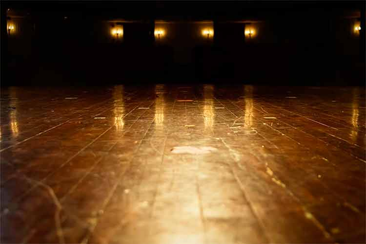 The wooden floor of an empty theatre stage